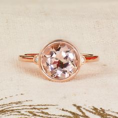 Gorgeous rose gold ring with bezel set morganite and diamond accents. Regularly $1,910. On sale for $1,432.50! Plus, save an additional 30% off the sale price with this coupon code: MISTLETOE17