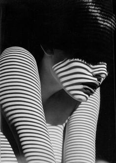 I like how the lines first make you think she's wearing a striped shirt, but it's actually the light from the blinds. It's interesting, and the black and white really adds to the effect