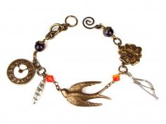 I would LOVE a charm bracelet of Harry Potter, Hunger Games, Percy Jackson, books, Jane Eyre, Jack London books, etc. ^_^