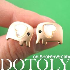 This is a listing for a pair of elephant stud earrings in light copper! These little elephants have small heart ears and are so super simple and cute!  Each one measures 1cm wide and is made with Titanium earring posts and backs so it is allergy free!  ---  Handling time: - Please allow... -Damneet