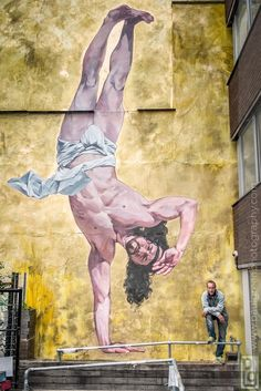 A wall in Bristol has been painted with a 8.5m breakdancing Jesus.