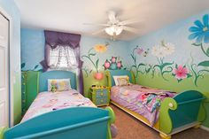 Tinker Bell and her fairy friends have used their pixie dust to decorate this whimsical twin bedroom in 7900 Plum Blossom Ct