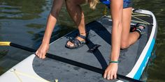 This article covers the basics of stand up paddle boarding (SUP) and includes info on essential gear and basic techniques on the water. Rei Outdoor, Inflatable Sup Board, Sup Paddle Board, Sun Protective Clothing, Snowboard Girl, Girls Football Boots, Skateboard Girl, Body Warmer, Regular Exercise