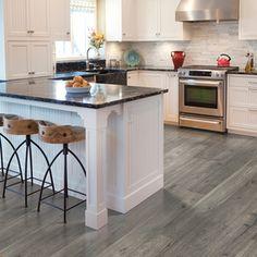 Grey laminate floor, white kitchen