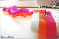 "what a great way to make ""party garland"" out of simple crepe paper.  Pretty!"