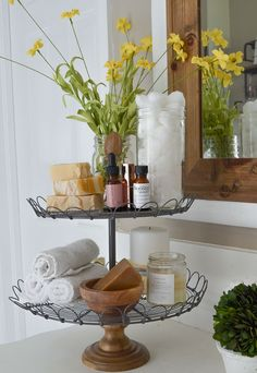 5 Ways to Style a Tiered Tray. Farmhouse style tiered tray in bathroom.