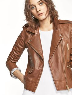 Nappa biker jacket made from 100% sheepskin leather with epaulette details. Tailored cut, notched lapel collar and crossover front zip fastening. Three zipped pockets and one pocket with a snapped flap, long sleeves with snapped cuffs, and lining. The back length for size S is 53 cm.