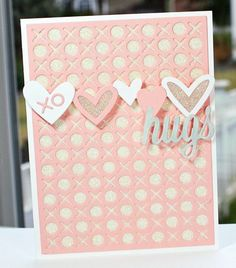 Peachy pink hugs (and kisses) card, with a row of hearts across