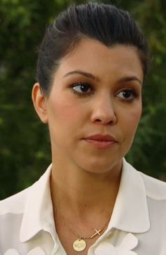 Kourtney might not be impressed with her monogrammed cross necklace, but we are!