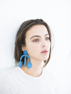 """It was a pair of oversized, oxidized blue earrings that first drew me to LA based designer Annie Costello Brown's warrior-like earrings. Each piece is hand cut and hammered out of burnished brass and silver - and as bold and audacious as they are, these dusters have a weightless and delicate"""