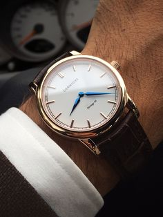 I absolutely love this men's watch. The rose gold and leather strap? Perfect. From Swedish watchmaker Corniche.