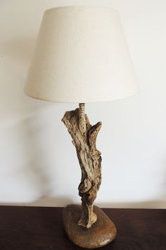 Driftwood lamp - This #lamp is made in Italy from the Tyrrhenian Sea #drifwoods and stone. The base is made of river stone.