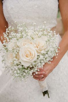 simple bouquet of ivory roses and baby's breath