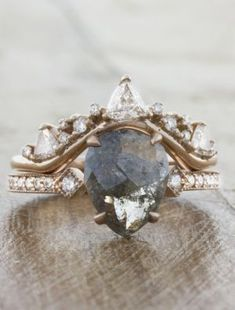 A one-of-a-kind engagement ring featuring a pear-shaped diamond paired with a stunning crown-shaped band. wedding bands Tempest: Intricate Wedding Ring with Trillion & Round Diamonds Ring Set, Ring Verlobung, Unique Wedding Bands, Wedding Jewelry, Wedding Ideas, Gold Wedding, Dream Wedding, Boho Wedding Ring, Custom Wedding Rings