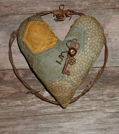 Prim Quilted Heart...with rusty barbed wire and key.