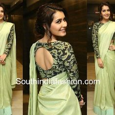 Raashi Khanna attended the pre-release function of her upcoming movie Touch Chesi Chudu wearing a plain green saree paired with black and green printed full sleeves blouse. Silver earrings and a soft updo rounded out her look! Full Sleeves Blouse Designs, Saree Jacket Designs, Saree Blouse Neck Designs, Fancy Blouse Designs, Bridal Blouse Designs, Saree Designs Party Wear, Fashion Show Dresses, Stylish Blouse Design, Designer Blouse Patterns