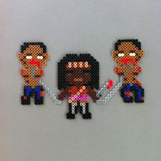 Female Zombie Slayer with two Zombies in tow perler por HarmonArt2