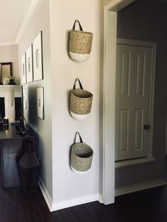 Love these seagrass, paint-dipped hanging baskets from Anthropologie! They look perfect hanging on my wall. I am obsessed with picture frames so anything else I actually like hanging on the wall is a great change of pace. White paint dipped baskets, hanging wall baskets, unique wall decor #afflinksponsored