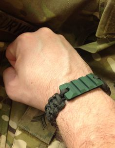 """Trooper"" -SpecMod-  New vision:    - Olive Drab Paracord with Black Dots   - Snap Shackle, Stainless Steel   - VMLS Picatinny Bracelet, Olive Drab Anodized Aluminium  - Olive Drab & Black Plastic Beads"