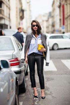 trending: the varsity jacket - gray + white varsity jacket worn with a button up shirt, leather pants, yellow clutch + pointed-toe heels