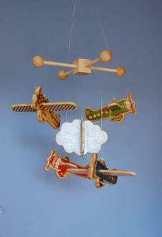 I still like airplanes for a boy...Baby Mobile - Baby Crib Mobile - Wooden Vintage Airplanes - Airplane Nursery. $90.00, via Etsy.