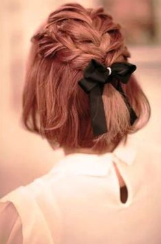 26 Short Wedding Hairstyles And Ways To Accessorize Them: red short hair with braids on top and a black bow with rhinestones for an elegant modern bride; #bridalhair