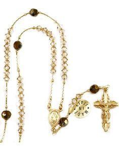 Clear #Swarovski crystal #beads with gold over sterling silver box chain, black #crystal paters, gold over sterling silver Miraculous medal center and a highly detailed Crucifix. The #Rosary comes with a certificate of authenticity. Made in #Italy.(sku 4-1402)