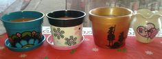 Variedad de macetas pintadas a mano, en barro o en plástico. Encargá la tuya a tu gusto!