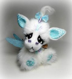 Dream By Michelle Nunnery - Dream has premium quality glass eyes. Eyes have eyelashes.Arms and legs jointed with string.Head is jointed with cotter pin and disk. Nostrils, and horns are made of clayFeet and earsare made of wool felt.Hand sewn.Hand designed.<br...