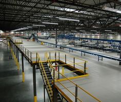A mezzanine is a level that is in between floors in a building. Usually, it's just like a balcony, in which the floor below it is visible. The mezzanine level shares exactly the same ceiling with. Warehouse Layout, Warehouse Design, Regal Industrial, Industrial Park, Atrium Design, Factory Architecture, Mezzanine Floor, Watch Storage, Building Code