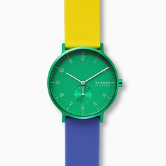 This limited-edition watch features a aluminum case with a sandblasted teal dial, linear and numerical indexes, three-hand movement and a seconds-tracking subdial at the 6 o'clock hour. Limited Edition Watches, Hand Watch, Skagen, Minimalist Design, Color Blocking, Watches For Men, Teal, Clock, Man Shop