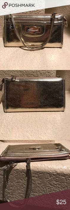 Seriously Gold Flaunt Wristlet by Faith Nicole Don't you just love this little splash of gold!!!! Imagine it swinging from your wrist with just about any outfit. Gently gently pre-owned. Faith Nicole. Flaunt Bags Clutches & Wristlets