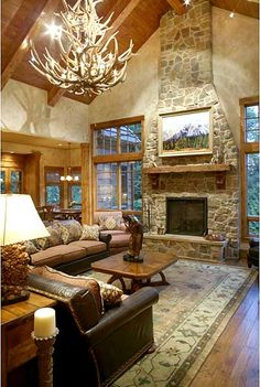 I love the theme of this living room. My favorite is the deer antler chanderleir.