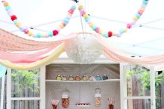 sprinkle party tent. Embroidery hope with fabric draped off of it!