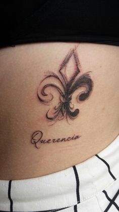 "Latest tattoo- fleur-de-lis which means ""three as one"" representing my two best friends and I. And ""Querencia"" which means ""the place from which one's strength is drawn, where one feels at home; the place where you are your most authentic self"""