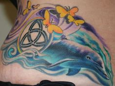 39 Pictures of Dolphin Tattoo Designs