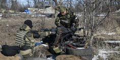 Fighters with the separatist self-proclaimed Donetsk People's Republic Army reposition a heavy machine gun at a checkpoint on the road from the town of Vuhlehirsk to Debaltseve in Ukraine February 18, 2015.