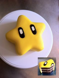 Super mario star cake - ~ 1 tier, 7'' round pan, 3 Chocolate layers, star shape sculpted  ~ Vanilla cream cheese frosting  ~ Homemade Marshmallow fondant, Americolor's Lemon yellow, Wilton's black