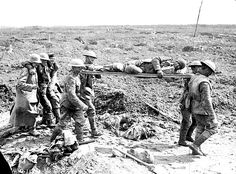 Stretcher bearers and German prisoners bringing in wounded at Vimy Ridge, during the Battle of Vimy Ridge. http://www.canadaatwar.ca/photos/vimy/vimy_3.jpg