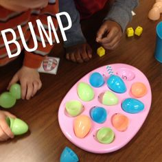 Use some festive plastic eggs and an egg plate to play subtraction bump!  So much fun they couldn't sit down.