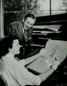 Walt checks out the inking and painting progress during the make of Alice In Wonderland.