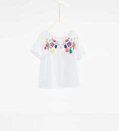 Large embroidered blouse