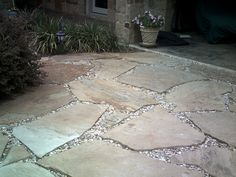 Flagstone and gravel patio. I want this in our sand area at the back of our middle yard. With a nice fire pit in the middle.  :0)