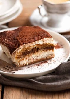Close up of a slice of Tiramisu on a white plate, ready to be eaten Italian Desserts, Just Desserts, Italian Recipes, Dessert Recipes, Italian Chef, Italian Tiramisu, Gourmet Desserts, Gourmet Foods, Italian Cooking