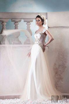 http://www.flip-zone.com/fashion/couture-1/independant-designers/hanna-touma-5615