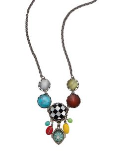 A color explosion:  Multi-colored glass drops hang from the onyx and mother of pearl inlaid checkerboard disk. Three faceted glass and a turquoise glass cabochon connect the disk to the antiqued silver-toned chain.