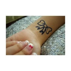 bow tattoo - maybe on my back?