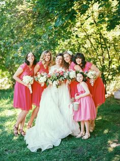 Bold and Bright Bridesmaids in Coral | Jacque Lynn Photography on @eadweddings via @aislesociety