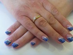 Angle french tip with gel polish and leopard print with glitter