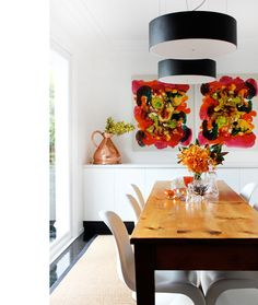 so many things i like in this room : big bright abstract art + wooden top but painted feet for the table + simple lines